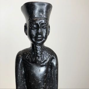 Black stone carving of Egyptian god Amun standing
